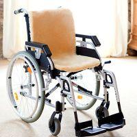 Lammfell Rollstuhlauflage natur